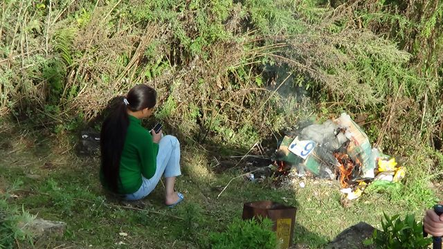 Nepal Garbage Burning Cell Phone Usage